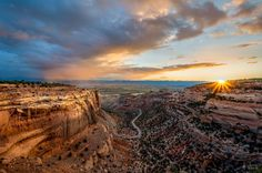 Sunrise over Colorado National Monument by William Woodward.
