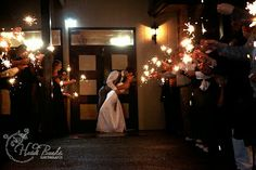 Bride & Groom kissing with sparklers Wedding photography Heidi Burks Photography  Includes article on wedding planning tips