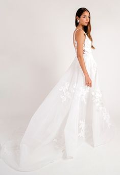 """Jenny Yoo's Miranda wedding dress NEW for Spring / Summer 2020 is one of our most  loved. Miranda is the definition of letting your dress do all the talking - effortless and timeless, with beautiful floral applique and an endlessly flattering silhouette. There's no easier choice than to say """"I Do"""" to the super lightweight Miranda gown. The Miranda is made with luxe Organza and Beaded Applique and features an invisible tulle insert.  Photo by This Modern Romance. Hair + Makeup by KC Witkamp"""