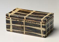 Shoji Hamada (Japanese, 1884-1978) stoneware with brown iron oxide, celadon glazes, and resist grid pattern decoration.
