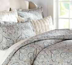 Mackenna Paisley Duvet Cover & Sham - Blue | Pottery Barn Jan. 2014. Love the paisley pattern, wish the blues were a little more intense. That diamond-tuck pillow in the background isn't bad, either.