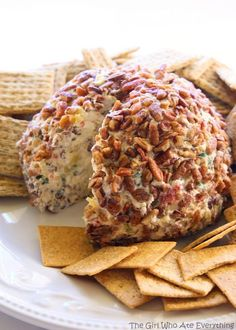 Hawaiian Cheese Ball - a cream cheese ball with crushed pineapple, green onions, and bell pepper. This is such a crowd pleaser. the-girl-who-ate-everything.com