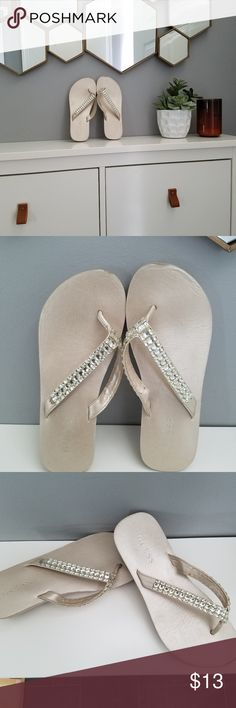 Guess Pearl Jeweled Sandals Pearlescent foam soled flip flops. Soles have about a 1.25 inch wedge heel. Size is unmarked but I wear a 7.5 and these fit perfectly.  Worn twice to weddings. 2nd and 3rd photos accurately show wear. Soles are in great condition. Ready for more dancing at your next summer fling! Guess Shoes Sandals