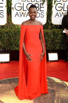 What: Ralph Lauren Where: Golden Globe Awards in 2014 Why: As the most buzzed-about actress for the past six months, Nyong'o had fashion hearts aflame in this caped gown.   - HarpersBAZAAR.com