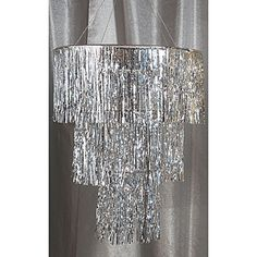 Hang the Silver Three Tier Chandelier for an ultra elegant look on a budget! Our silver tier chandlier is made of thousands of carefully detailed metallic mylar strands with chrime hanging chains.