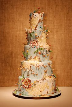 Pale Blue & Ivory Wedding Cake with Gold Piping Detail and Whimsical Flowers & VInes