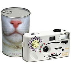 """Shironeko Holga : The Cat Camera!  """"The White Cat Holga is not just a camera, it's meow producing light up Toy Cam designed to attract your feline friends. A favorite around the shop, especially with our kitten Gracie, the Shironeko comes in a stunning Can that you will want to display along with your collection of Toy Cameras. Shoots 35mm film, and has a button that makes the lights light up and the Meow sounds spurt from the camera. """" $40  No idea what the can is for. Kooky!"""