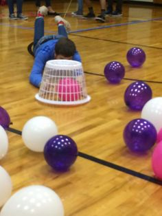 Hungry Hippos!  Use balloon colors to coordinate with holidays or seasons. Skateboards, laundry baskets, and balloons.