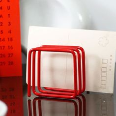 Block Design red wire letter rack