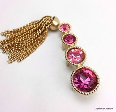 """Vintage Sarah Coventry """"Saucy"""" Bar Pin, Gold with Pink Rhinestones Brooch Pin with Tassel, 1960's Signed Designer Pin, Goldtone Pink Brooch by JamieRayCreations on Etsy #SarahCoventry #pinkbrooch #rhinestonebrooch #1960sjewelry #goldtasselbrooch #vintagebarpin https://www.etsy.com/listing/260118671/vintage-sarah-coventry-saucy-bar-pin"""