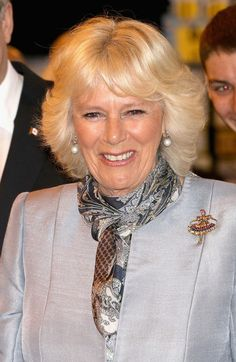 Camilla, Duchess of Cornwall laughs as she visits Stevenson Campus Air Hanger on May 21, 2014 in Winnipeg, Canada.