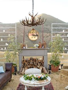 Outdoor lounge area for wedding reception...fireplace, sofas, hanging lights. » WOW, if I ever attended a wedding that looked like this I would be psyched!