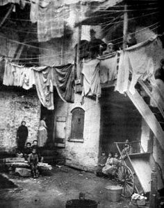 Baxter Street Court by Jacob Riis c. 1895 24 Aug '11 Baxter Street Court, in the Five Points slums of New York in 1895, as photographed by Jacob Riis or one of his three uncredited assistants.
