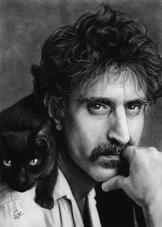 "Frank & his feline friend. For those unfamiliar with Zappa's music, listen to ""Peaches En Regalia"" (http://www.youtube.com/watch?v=BmEXyXVVp24) & ""Cosmik Debris"" (http://www.youtube.com/watch?v=LjPlhb4f9P8) for a crash course."