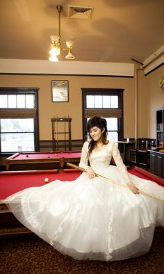 Wedding photo posed on our antique pool tables in our Billiards Room