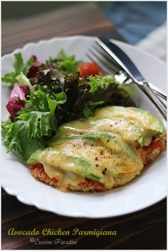 AVOCADO CHICKEN PARMIGIANA  --2 Chicken Breast Fillets, halved lengthways,1/2C Plain Flour, 2T Fresh Milk, 2 Eggs,1 1/2C Dried Breadcrumbs,2T Olive Oil/Cooking Spray,1/2C Tomato Pasta Sauce,   2 Avocado, Sliced,1/2C Grated Mozzarella Cheese ,Salad Green, to serve-SEE LINK INSTRUCTIONS