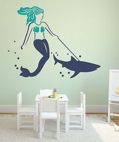 Turn the bedroom wall into an underwater aquarium with this set of removable and repositionable shark and mermaid decals. Complete with all the tools necessary for easy application and featuring a practice decal for any unforeseen mishaps, it adds a dose of deep-sea décor to any room.