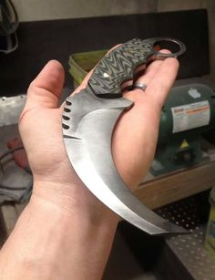 Custom karambit knives, guns, and tactical gear