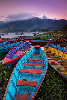 Pokhara<br>Nepal<br><br> <br /><br>One of the main attractions of Pokhara is the shore of Lake Phewa (Phewa Tal) . Colourful boats line the shores where their owners tout short tours across the lake. At dawn, Macchapucchre ( Fish Tail Holy Mountain ) is visible when the skies are clear. Photographer : Marianne Lim