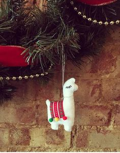Handmade llama Christmas felt decoration with polyester filling, patterned material and Pom Pom saddle with the option of either gold or silver thread bridle and hanging. Item is the same on both sides. Dimensions approx 11cm x 7cm  Gift wrap is available this Christmas as well as