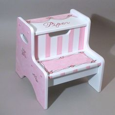 A step stool with two steps allows a child to reach higher, and this hand painted and personalized Wispy Ribbons stool lets a girl do it in style. $109.95