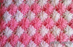O padrão de flores exuberantes colunas.  Descrição do esquema de tricô, um tutorial em vídeo