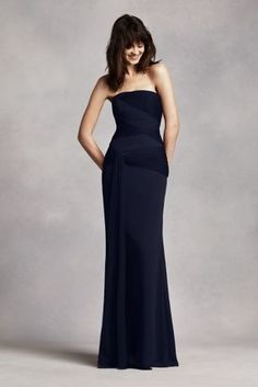 Long and luxurious bridesmaid dress with beautifully draped bodice and soft flowing sash.   Strapless column gown features asymmetrical draped bobbin net bodice and flowing sash.  Available in seleect stores and online.  Sizes 16-26 are available in stores only.  Fully lined.Side zip. Dry clean only.  Imported.