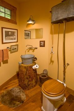 Had to add this - too funny! Maybe I should go for a rustic outhouse look? Shower could have a hose with a tin can showerhead! Powder Room Design, Pictures, Remodel, Decor and Ideas - page 33 Rustic Bathroom Lighting, Rustic Bathroom Designs, Rustic Bathroom Vanities, Rustic Bathrooms, Rustic Lighting, Lighting Design, Small Bathrooms, Lighting Ideas, Bathroom Chandelier