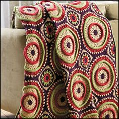 I'm not a crochet fan but and I don't like granny squares but this looks fabulous: Ringtoss Afghan ~ crochet pattern available via ravelry {crochet world magazine} Crochet Afghans, Ravelry Crochet, Crochet Books, Afghan Crochet Patterns, Love Crochet, Crochet Motif, Beautiful Crochet, Crochet Designs, Crochet Crafts