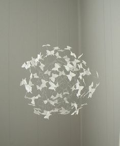 I just love this idea of a butterfly swarm for a crib mobile!