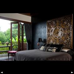 The lattice art piece behind the bed creates a beautiful looking headboard.
