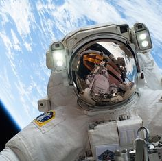 "The best selfie ever is the one an astronaut takes from freaking space -- ""On Dec. 24, 2013, NASA astronaut Mike Hopkins, Expedition 38 Flight Engineer, participates in the second of two U.S. spacewalks, spread over a four-day period, which were designed to allow the crew to change out a faulty water pump on the exterior of the Earth-orbiting International Space Station. He was joined on both spacewalks by NASA astronaut Rick Mastracchio, whose image shows up in Hopkins' helmet visor."""