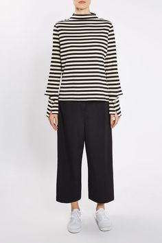 Add serious edge to your wardrobe in this funnel neck stripe shirt by Boutique, complete with cool deconstructed cuffs with popper fastening. Style with black culottes for a monochrome-feel.