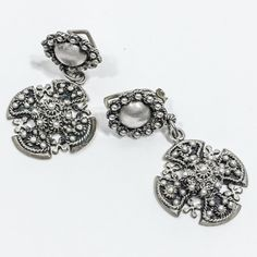 A personal favorite from my Etsy shop https://www.etsy.com/listing/247713239/vintage-jerusalem-maltese-cross-earrings