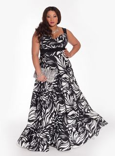 """You'll feel as stunning as you look when you wear this divine and vibrantly colored maxi dress featuring a Black/ivory floral print on a gorgeous fabric. Adorn this look with colorful stones or keep it classic with some pearls. Add strappy pumps and a minaudiere in tow you're set to go! Shoulder to Hem Length: 60""""63"""" Fit Note: Fit Note: Use bust measurement to determine size Bias cut bodice is shaped with flattering pleats Stretch empire waistband and brafriendly straps Fulllength flared ..."""