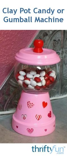 Make this cute, inexpensive candy machine for Valentine's Day or decorate for any occasion. It makes a nice gift for a friend or co-worker. Clay Pot Projects, Clay Pot Crafts, Diy Clay, Craft Projects, Valentine Decorations, Valentine Crafts, Flower Pot Crafts, Flower Pots, Diy Gumball Machine
