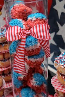 Great for July 4th-Dyed Rice Krispie Treats dipped in white chocolate with blue sprinkles!