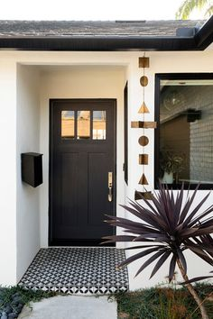 Exterior with black accents via DOMINO