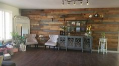 Our hand made wall from pallets is everything! I had to share with the pinterest world!  #slatwall #palletproject