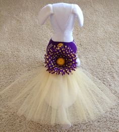 Brand new size small LSU Logo print fabric with gold tulle dog tutu dress. Description from etsy.com. I searched for this on bing.com/images