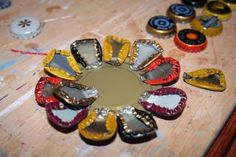 The beginning of a bottle cap flower. Live In Art: Top Ten Things To Do With Bottle Caps