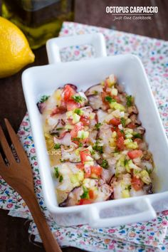 Delicious octopus carpaccio with thinly sliced octopus drizzled with lemon and olive oil, topped with chopped cucumber, tomato, and sweet onion. Octopus Recipes, Fish Recipes, Seafood Recipes, Asian Recipes, Cooking Recipes, Healthy Recipes, Ethnic Recipes, Seafood Appetizers, Drink Recipes