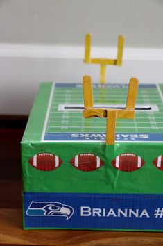 My daughter came up with the idea to have a Seahawks football field adorn her valentine box for school.