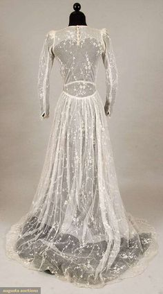 WHITE WEDDING GOWN, 1930s Cotton net w/ allover delicate tambour flowers, trained skirt, long sleeves, white tulle lining.