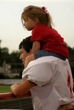 Awww i love this.big brother carrying little sister after a game.i bet he does t