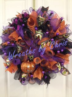 Cute Halloween spiral wreath with lots of pattern and color. Wreaths by Chris