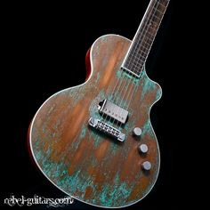 Berumen Copper Top Verdigris Patina $2495. Copper top with a nice patina creating a cool finish. Plus the small lower cutaway is nice.