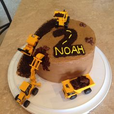 Construction cake for my 2 year old boy. He loves trucks and diggers.