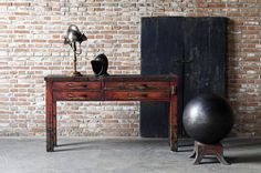 """Van Thiel & Co. From Left to Right: """"The Randall Silversmith Table, The Iron Orb-- Four Hands"""