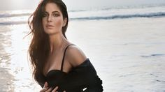Trust Katrina Kaif to wow the audience with her sensuous photo shoots and glamorous pictures. The 'Jagga Jasoos' actress recently to Instagram and shared a picture where she's seen striking a sexy pose and flaunting her perfectly toned legs in an off-white long lace dress, which has hip-high slits.